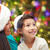 happy mother and little girl in santa hats at home stock photo © dolgachov