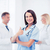 team of doctors showing thumbs up stock photo © dolgachov