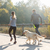close up of couple with dog running outdoors stock photo © dolgachov