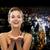 смеясь · женщину · вечернее · платье · что-то · люди - Сток-фото © dolgachov
