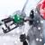 close up of fuel hose nozzle in car tank stock photo © dolgachov