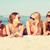 group of smiling women in sunglasses on beach stock photo © dolgachov