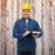 smiling male builder in helmet with clipboard stock photo © dolgachov