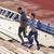 couple running upstairs on stadium stock photo © dolgachov