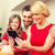 smiling family with tablet pc stock photo © dolgachov