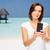 happy woman taking selfie by smartphone over beach stock photo © dolgachov