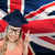student woman in mortarboard over english flag stock photo © dolgachov