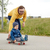 happy father and little son riding on skateboard stock photo © dolgachov