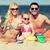 gelukkig · gezin · spelen · zand · speelgoed · strand · familie - stockfoto © dolgachov