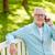 senior man calling on smartphone at summer park stock photo © dolgachov