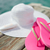 close up of hat sunscreen and slippers at seaside stock photo © dolgachov