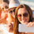 close up of smiling women with smartphone on beach stock photo © dolgachov