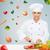smiling female chef chopping vegetables stock photo © dolgachov