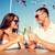 smiling couple drinking champagne at cafe stock photo © dolgachov
