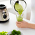 close up of woman with blender jar and green shake stock photo © dolgachov