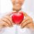 woman hands with heart stock photo © dolgachov