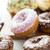 close up of glazed donuts pile on table stock photo © dolgachov