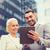 mosolyog · üzletemberek · táblagép · város · üzlet · együttműködés - stock fotó © dolgachov