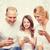 mutlu · aile · akıllı · telefonlar · ev · aile · ev · teknoloji · insanlar - stok fotoğraf © dolgachov