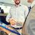 happy man shaking hands in auto show or salon stock photo © dolgachov