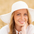 close up of happy woman in sun hat on cereal field stock photo © dolgachov