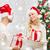 felice · Coppia · Natale · presenti · seduta - foto d'archivio © dolgachov