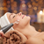close up of young woman having face massage in spa stock photo © dolgachov