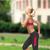 mulher · saltando · caminho · sorrindo · sorridente · energia - foto stock © dolgachov