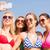 group of smiling women making selfie on beach stock photo © dolgachov