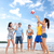 group of happy friends playing beach ball stock photo © dolgachov