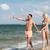 paar · strand · gelukkig · man · wijzend - stockfoto © dolgachov