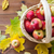 close up of basket with apples on wooden table stock photo © dolgachov