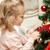 little girl decorating christmas tree at home stock photo © dolgachov