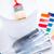 paintbrush paint pot gloves and pantone samples stock photo © dolgachov