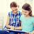 gülen · aile · iki · kitap · çocuk - stok fotoğraf © dolgachov