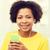 boldog · afrikai · nő · okostelefon · otthon · emberek - stock fotó © dolgachov