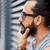 hombre · gafas · de · sol · tocar · barba · calle · de · la · ciudad · estilo · de · vida - foto stock © dolgachov