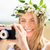 happy woman with film camera in wreath of flowers stock photo © dolgachov
