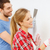 smiling couple doing renovations at home stock photo © dolgachov