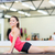smiling teenage girl stretching on mat in the gym stock photo © dolgachov