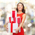 smiling woman in red dress with gift box stock photo © dolgachov
