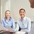 smiling businesswomen meeting in office stock photo © dolgachov