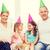 happy family with two kids in hats celebrating stock photo © dolgachov