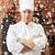 happy male chef cook in restaurant kitchen stock photo © dolgachov