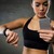 woman with heart rate watch and smartphone in gym stock photo © dolgachov