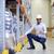 boldog · férfi · munkavédelmi · sisak · raktár · raktár · szállítmány - stock fotó © dolgachov