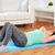 plus size woman exercising on mat at home stock photo © dolgachov