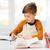 mosolyog · diák · fiú · ír · notebook · otthon - stock fotó © dolgachov