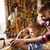 father and son with plane shaving wood at workshop stock photo © dolgachov