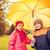 happy boy and girl with umbrella in autumn park stock photo © dolgachov